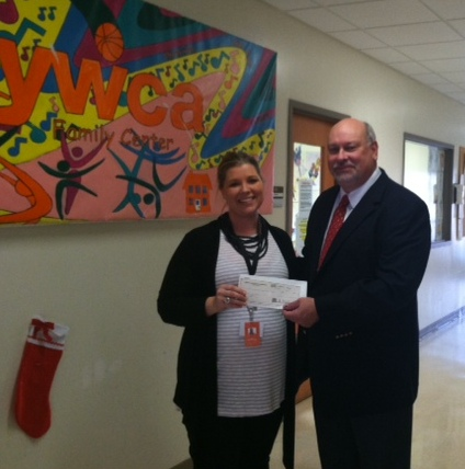 Neal Bronder, Vice President & CEO of Renier makes a donation to the YWCA Family Center on behalf of Renier.